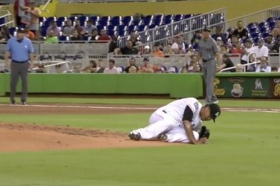 Marlins pitcher Hernandez falls off mound for balk, still strikes out hitter