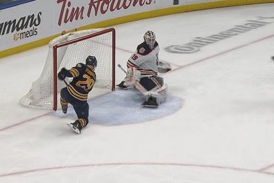 Buffalo Sabres' Jason Pominville blocks own shot from entering net
