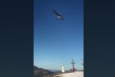 French ski resort uses helicopter to air-lift snow amid high temperatures