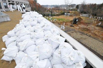 Japan official apologizes for accusing Fukushima prosecutors of 'fleeing'