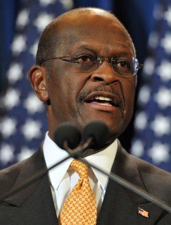 Cain jokes about Anita Hill