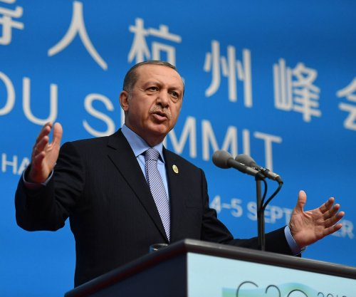 Turkey's president wants to rid Islamic State; 28 mayors accused of terrorism replaced
