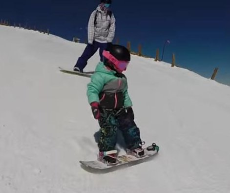 Snowboarding 3-year-old takes on steep Colorado slope