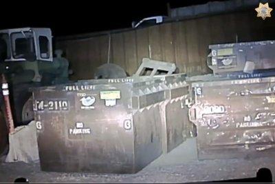 Deputy rescues bear cub from California trash bin