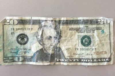 Seattle woman receives fake movie money from ATM