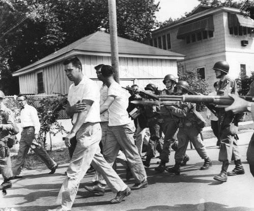 Negroes slip by angry mob, enter school; whites leave