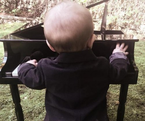 Carrie Underwood shares photo of son playing piano