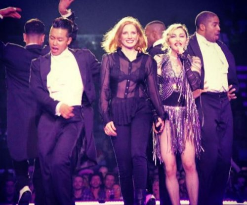 Watch: Jessica Chastain delivers onstage spanking to Madonna