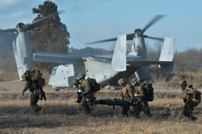 Japan's ruling party proposes increasing defense budget