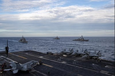 Roosevelt, Nimitz strike groups conduct operations in South China Sea