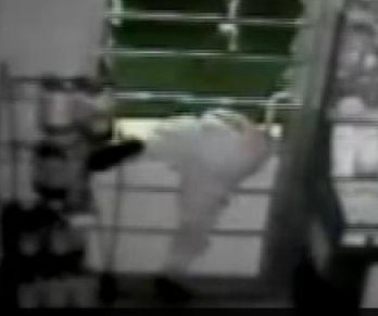 Police: Flexible burglar squeezed through bars
