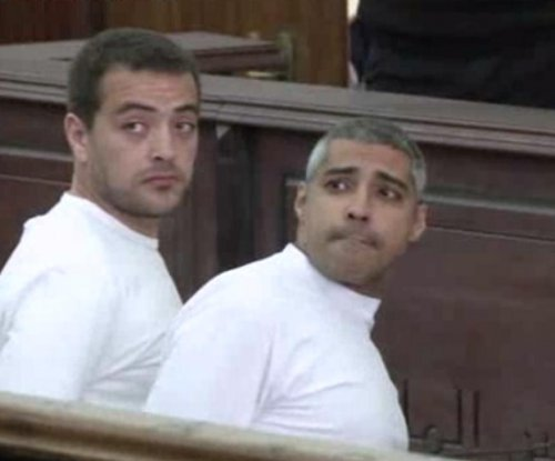 Imprisoned Al-Jazeera journalists receive retrial date by Egyptian court