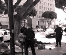 Los Angeles police chief says man killed on Skid Row tried to grab cop's gun