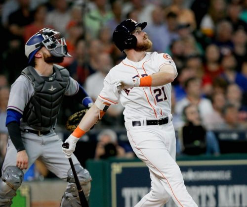 Rookie Derek Fisher helps Houston Astros to 5-0 victory over Philadelphia Phillies