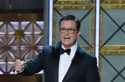 Colbert, Anderson and Janney open Emmys with song and dance number