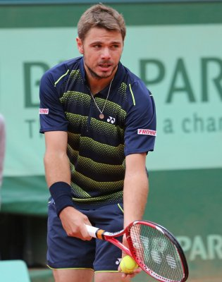 No. 1 Wawrinka survives Morocco challenge