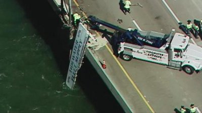 Tractor trailer dangles off edge of Monitor-Merrimac Memorial Bridge Tunnel