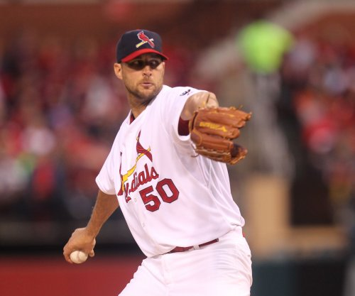 St. Louis Cardinals add Cooney; place Wainwright on 60-day DL