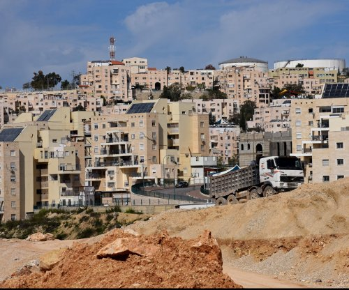 Israel agrees to $20 million more for settlements