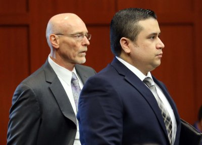 Victim's family asks for prayers as Zimmerman's defense seeks delay