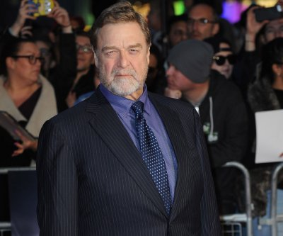 John Goodman shows off slim physique at 'Trumbo' screening