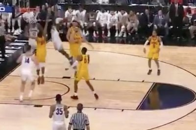 Arizona's Alkins demolishes USC defender with two-handed slam