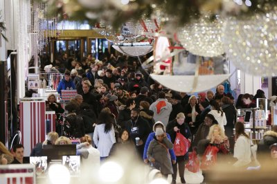Holiday shoppers spending more, retailers fight to replace Toys R Us