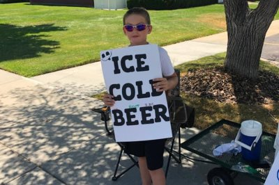 Police called to boy's 'ice cold beer' stand find 'root beer' instead