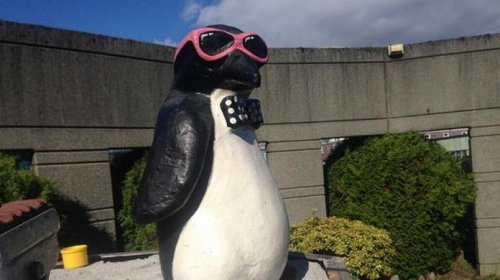 Penguin statue appears in nude Satan's former home