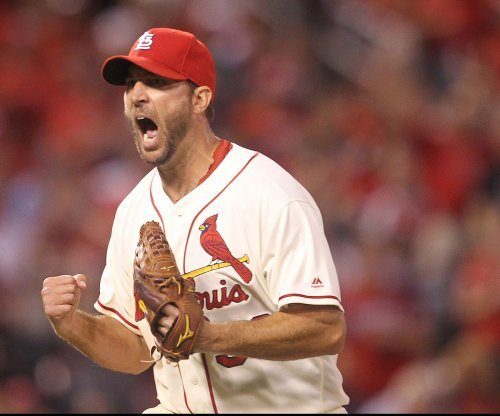 Adam Wainwright powers St. Louis Cardinals past Colorado Rockies