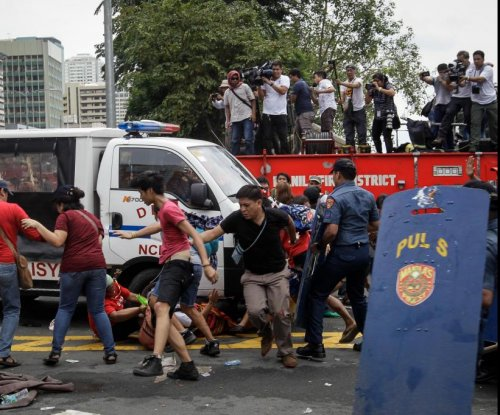 Nine police officers in Philippines fired over violent U.S. military protest