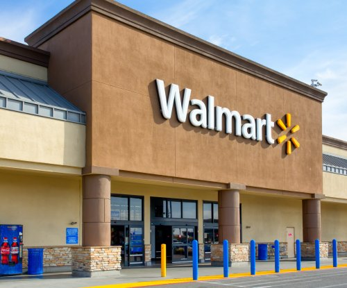 Wal-Mart plans 'holiday helpers' to speed up checkout this fall