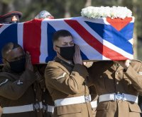 Captain Sir Tom Moore, who raised millions for the NHS, laid to rest