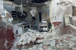 At least 18 killed in missile attack on Syrian town, hospital