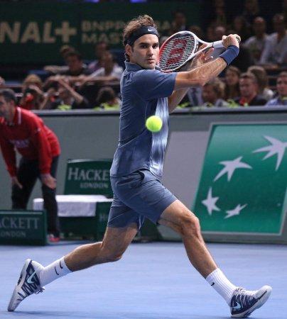 Federer through to quarterfinals in Brisbane