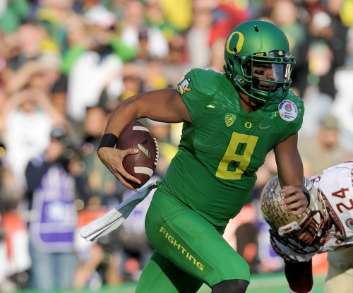 Oregon routs Florida State 59-20 in 1st semifinal