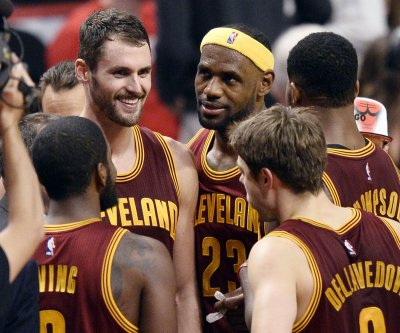 LeBron James, Cavs win hard-fought battle vs. Nets