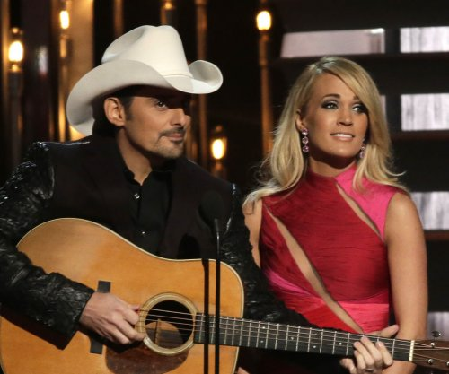 Carrie Underwood, Brad Paisley to host 2016 CMA Awards