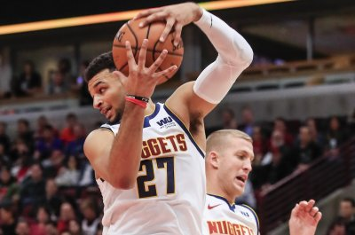 Nuggets' Jamal Murray snipes half-court heave vs. Warriors