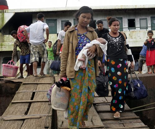 Thousands flee violence in Myanmar's Rakhine