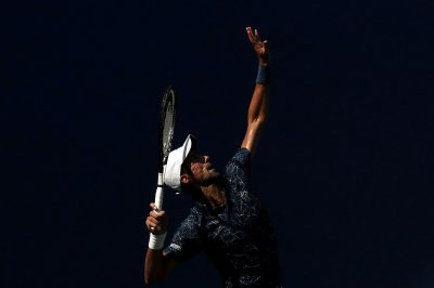 U.S. Open: Roger Federer, Novak Djokovic roll on day two
