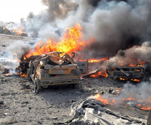 Syria: Suicide bombers kill dozens in Homs and Damascus