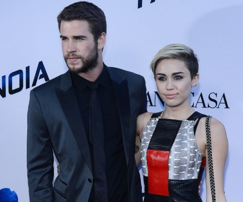 Miley Cyrus, Liam Hemsworth pay surprise visit to children's hospital