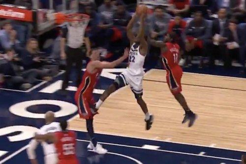 Andrew Wiggins kicks defender during poster dunk