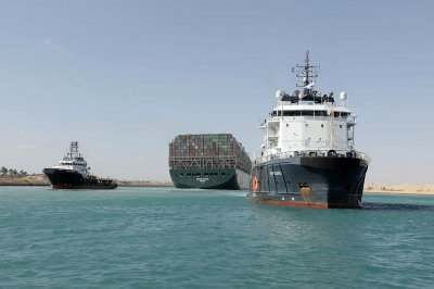 Authorities investigate how container ship became stuck in Suez Canal