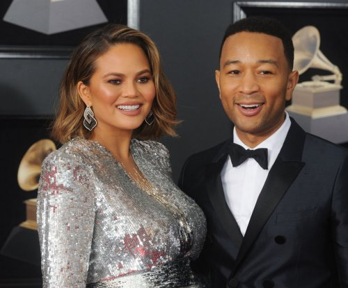 Chrissy Teigen explains why she didn't take John Legend's last name