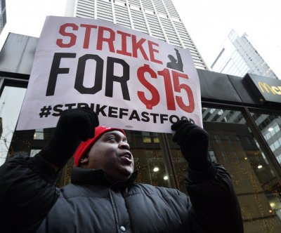 U.S. businesses take minimum wage hikes, sick leave to court