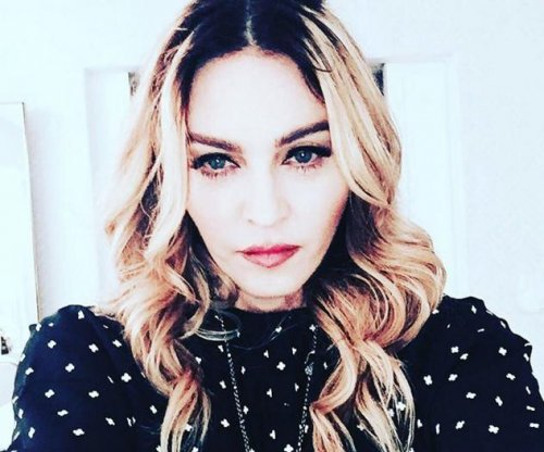Madonna 'moving forward' amid tense custody battle