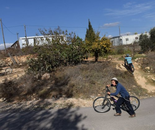 Amona, West Bank, residents reject plan to demolish their settlement