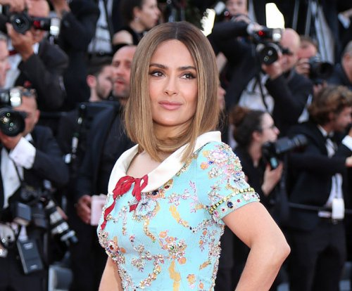 Salma Hayek debuts ombre hair at Cannes soiree